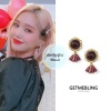 200108 at Eternally live and special event in Tokyo wearing Getmebling - antique muse earrings ₩30,000 pic cr: